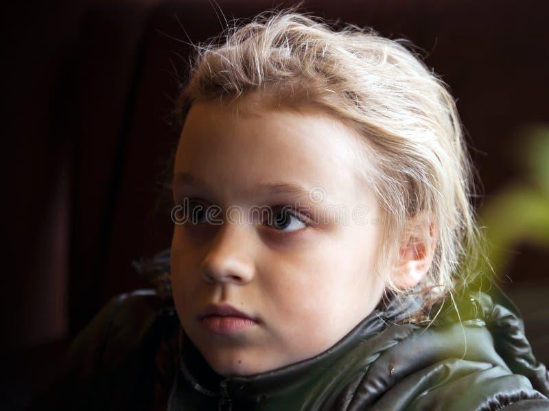 Outdoor portrait of a little blond girl