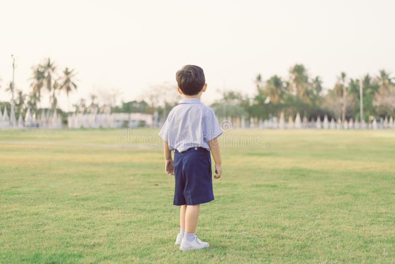 Outdoor portrait of a Lonely Asian student kid in school uniform standing stock images