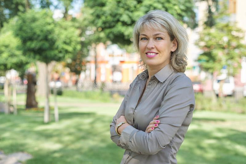 Outdoor portrait of mature businesswoman on city street royalty free stock photos