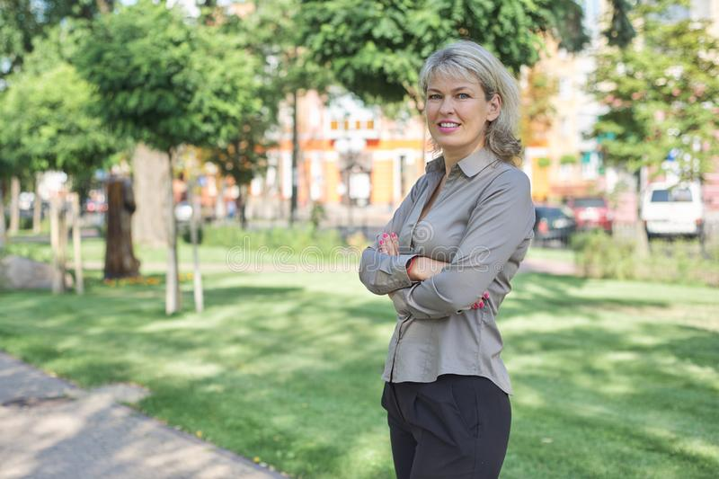 Outdoor portrait of mature businesswoman on city street stock photos