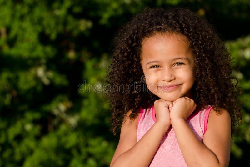 Outdoor portrait of pretty mixed race girl stock photos