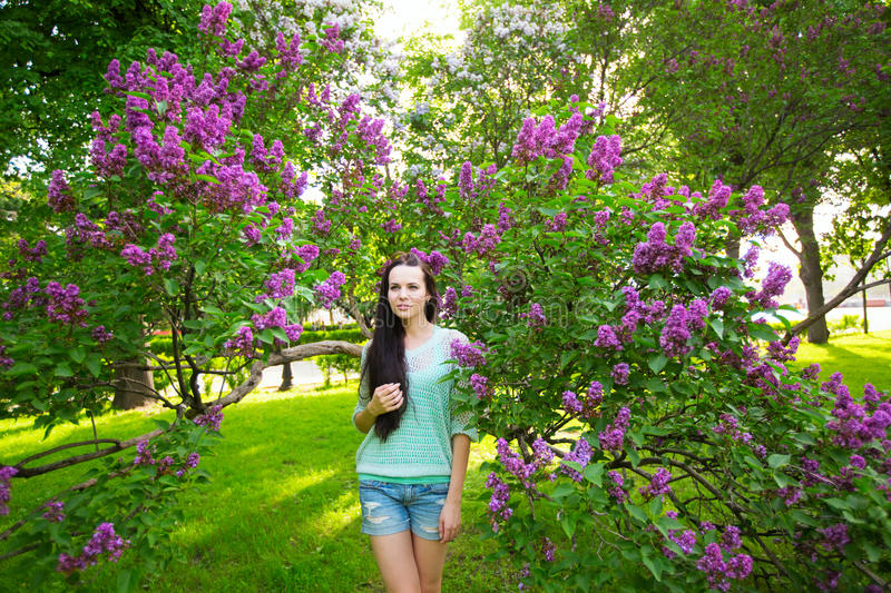 Outdoor portrait Pretty woman with long healthy hair in the park. royalty free stock photo