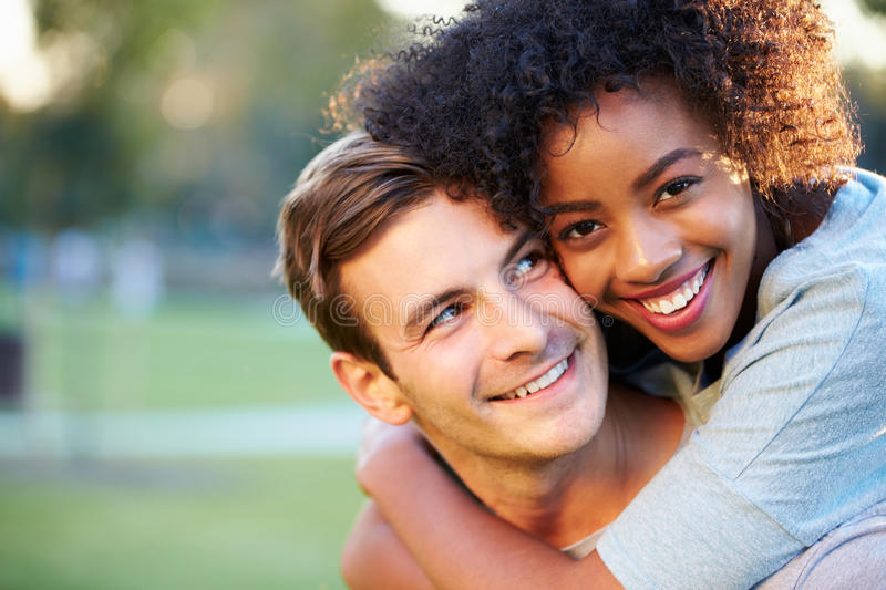 Outdoor Portrait Of Romantic Young Couple In Park royalty free stock photography