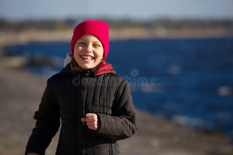 Outdoor portrait of running cheerful little girl