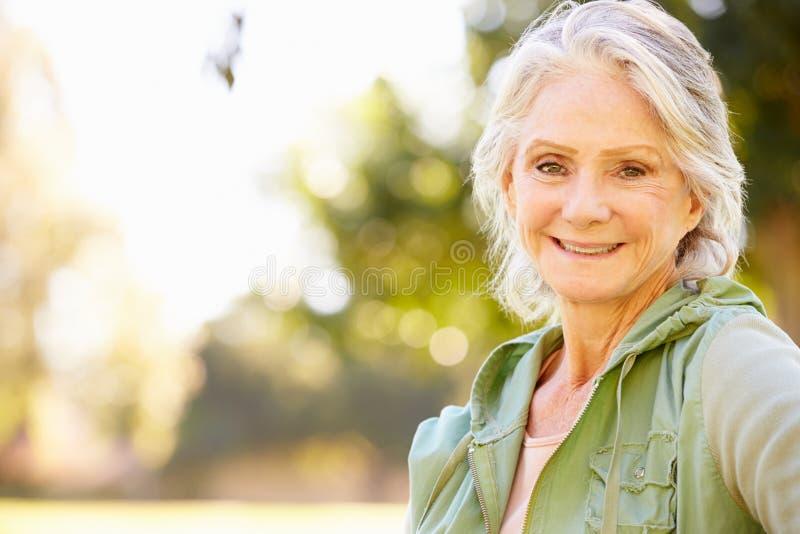 Outdoor Portrait Of Smiling Senior Woman stock photo
