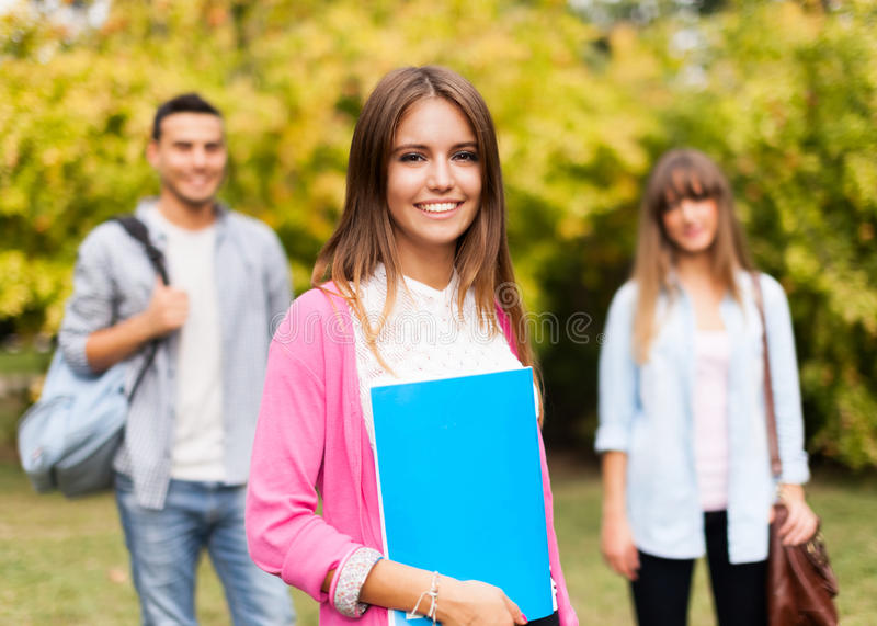 Outdoor portrait of a smiling student royalty free stock images