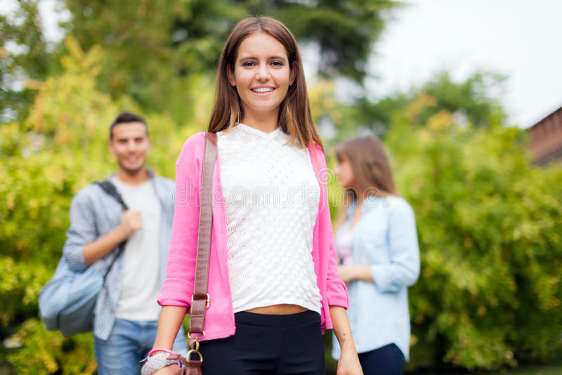 Outdoor portrait of a smiling student stock image