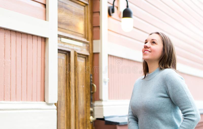 Outdoor portrait of smiling woman wearing sweater. royalty free stock image
