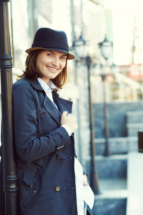 Outdoor portrait of a stylish woman with hat in street royalty free stock image