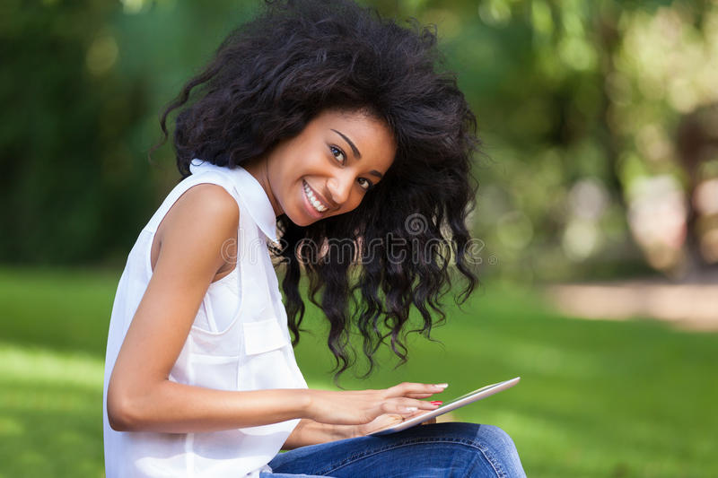 Download Outdoor Portrait Of A Teenage Black Girl Using A Tactile Tablet Royalty Free Stock Image - Image: 32995046