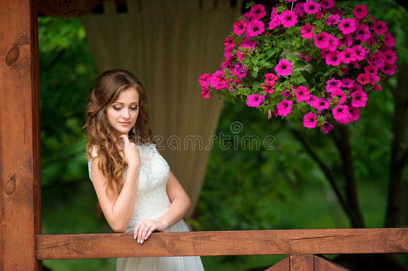Outdoor portrait of young beautiful fashionable lady posing near stock photos