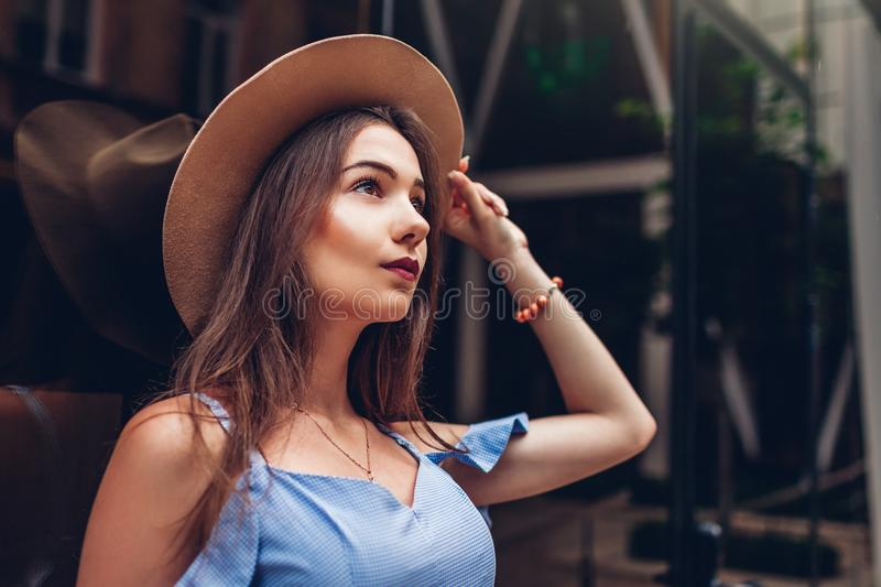 Outdoor portrait of young beautiful fashionable woman wearing stylish accessories. City fashion royalty free stock photography