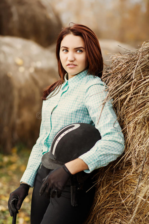 Outdoor portrait of young beautiful woman. Horsewoman. Outdoor portrait of young beautiful woman royalty free stock photos
