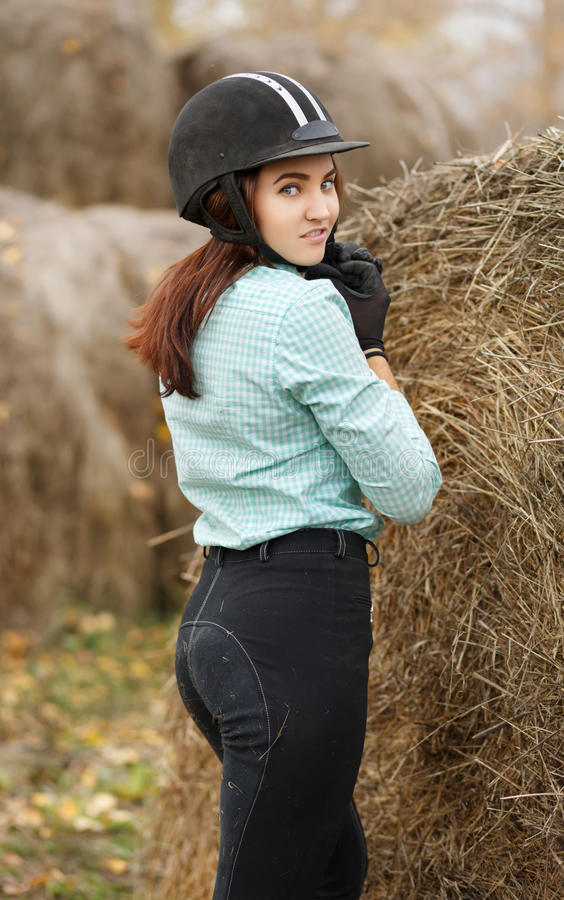 Outdoor portrait of young beautiful woman. Horsewoman. Outdoor portrait of young beautiful woman. Lifestyle concept stock images