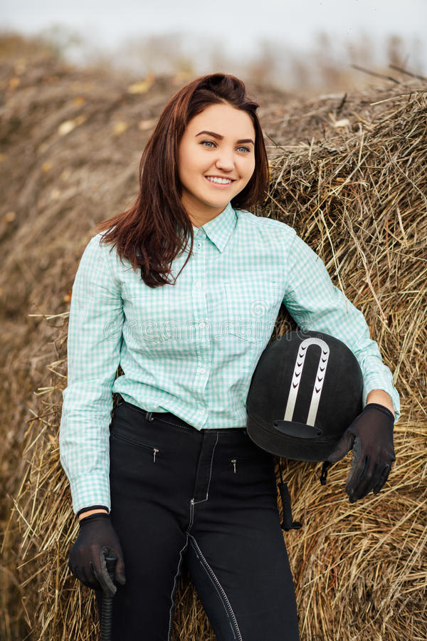 Outdoor portrait of young beautiful woman. Horsewoman. Outdoor portrait of young beautiful woman. Selective focus stock photos