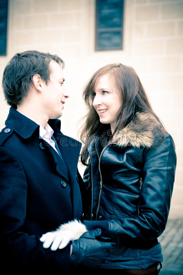 Outdoor portrait of a young couple in love stock images