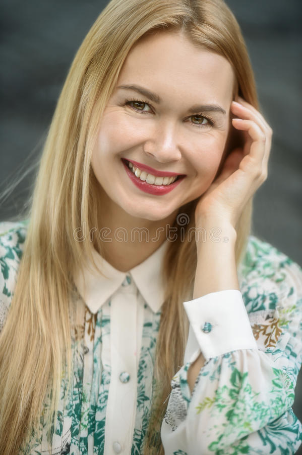 Outdoor portrait of young happy blonde girl. stock photo