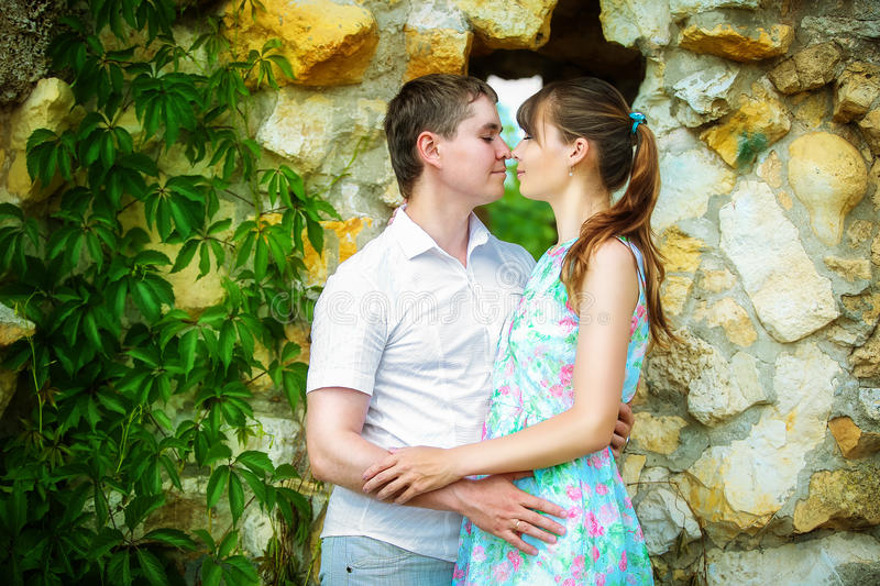 Outdoor portrait of young sensual couple. Love and kiss. Summer stock photos