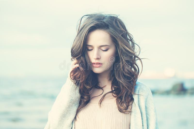 Outdoor Portrait of Young Woman Looking. At Camera on Natural Background with Copy Space royalty free stock photography