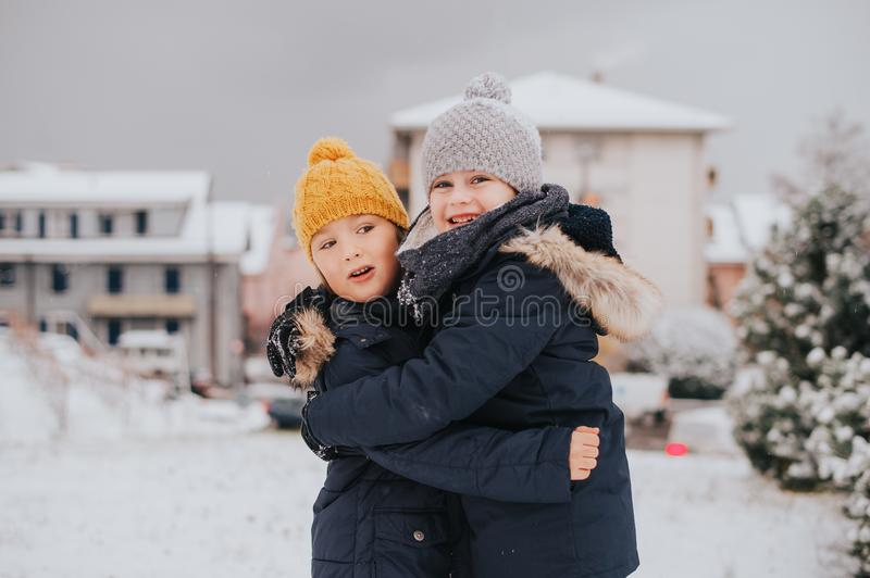 Outdoor portrait of young 6 year old boys wearing warm jacket stock photos