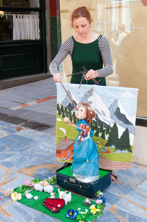 Outdoor puppet show. By only one lady in Catragena, Spain stock photo