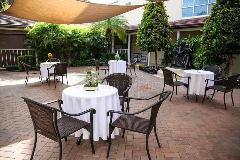 Outdoor restaurant. Chairs and tables in outside patio dining area stock image