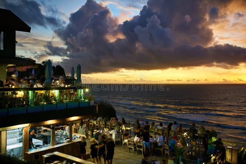 Outdoor restaurant in balinese style on sunset sea background stock photos