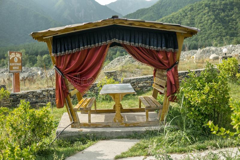Outdoor restaurant or cafe table set up with mountain landscape background. stock images