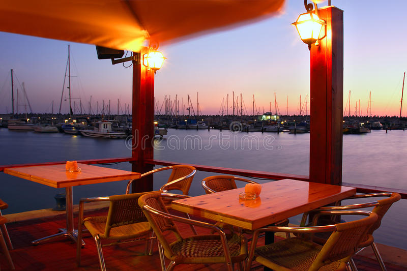 Outdoor restaurant on marina at evening. Outdoor restaurant on marina at Mediterranean sea at evening in Ashqelon, Israel royalty free stock image