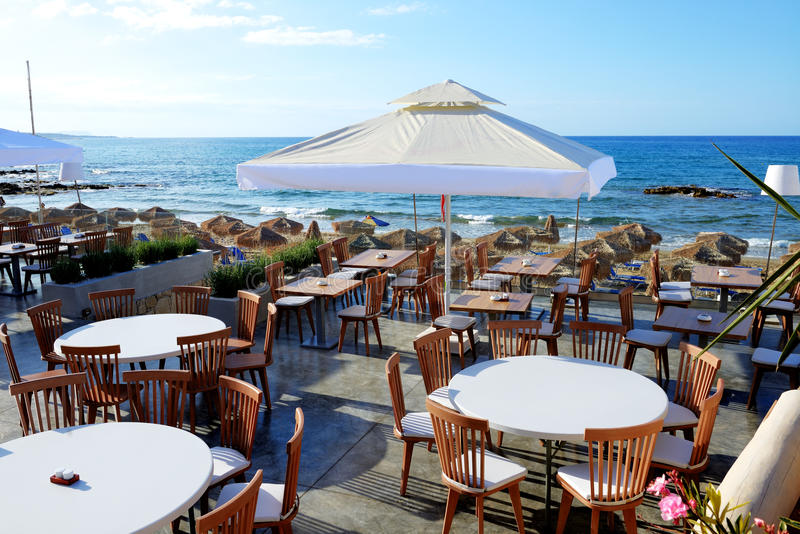 The outdoor restaurant near beach at luxury hotel stock images