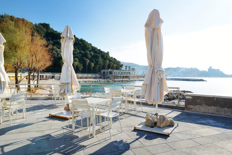 Outdoor restaurants and cafes on a seafront of Lerici town, a part of the Italian Riviera, Italy. Outdoor restaurants and cafes on a seafront of Lerici town royalty free stock images