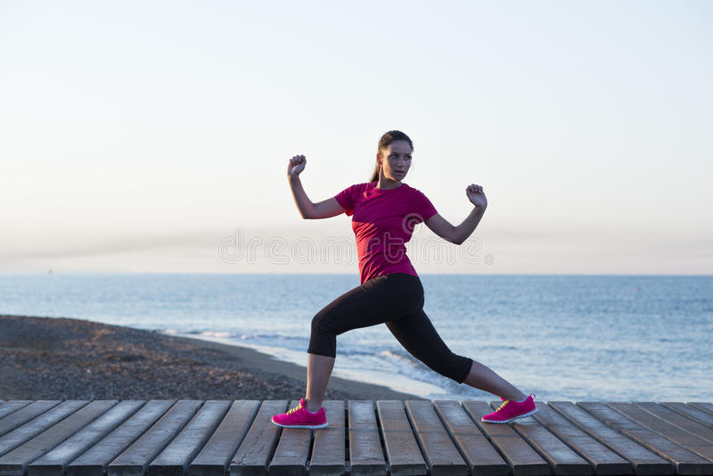 Outdoor runner. Young woman is running in sunny nature royalty free stock photos