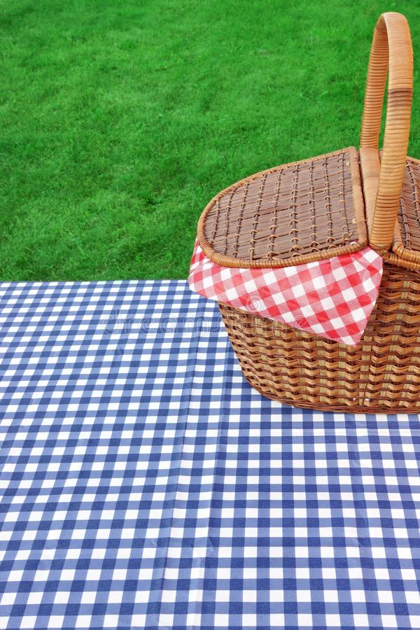 Outdoor Rustic Picnic Table With Hamper And Blue Tablecloth. Outdoor Rustic Picnic Table With Hamper And Blue Checkered Tablecloth On The Lawn In The Park Rest stock image