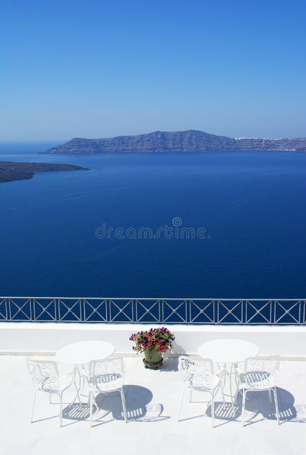 Outdoor seating at the terrace,Oia,Santorini island, Caldera, Ae royalty free stock photos