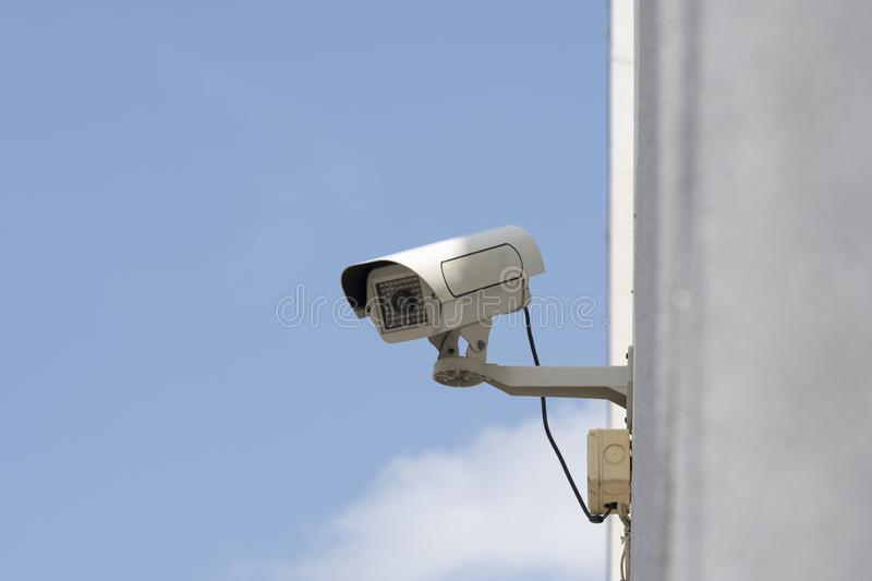 Outdoor security cameras in garden. On blue sky background royalty free stock photo