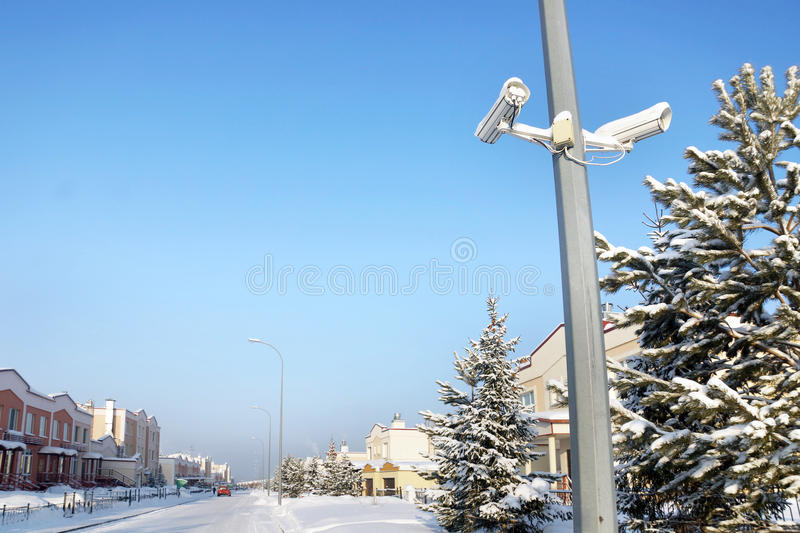 Outdoor security cameras at the street. In a winter town stock photos