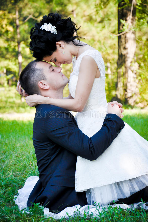 Outdoor sensual portrait of young beautiful couple in love stock photography