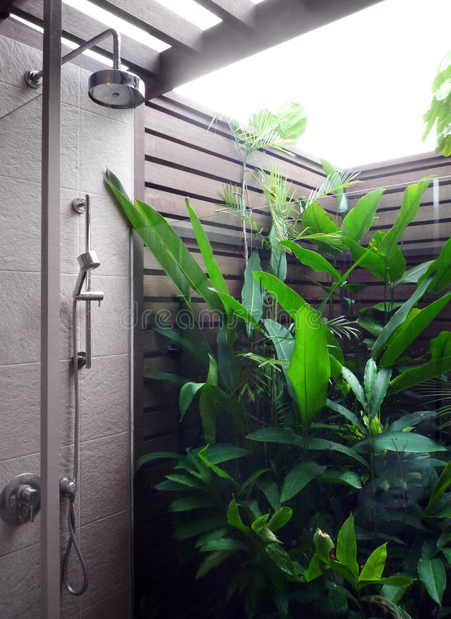 Outdoor shower area of modern resort. A photograph of a new concept in bathrooms - partially outdoor bathroom shower space of a modern styel holiday resort, with royalty free stock images