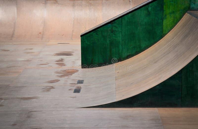 Outdoor skate park, rails, ramps. Outdoor skate park background with rails; U shape ramps. Wooden skate, bike park for tricks, jumps stock photos