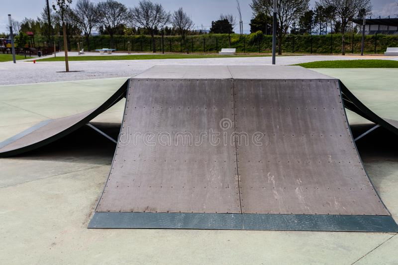 Outdoor skatepark with various ramps  with a cloudy sky.  royalty free stock photos