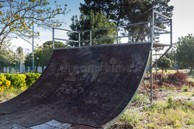 Outdoor skatepark with various ramps  with a cloudy sky.  royalty free stock photo