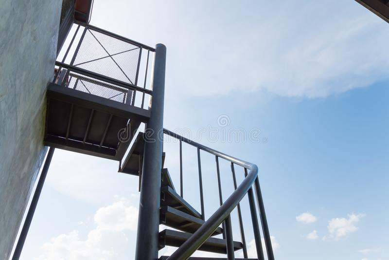 Outdoor spiral staircases from bottom view with blue sky royalty free stock images