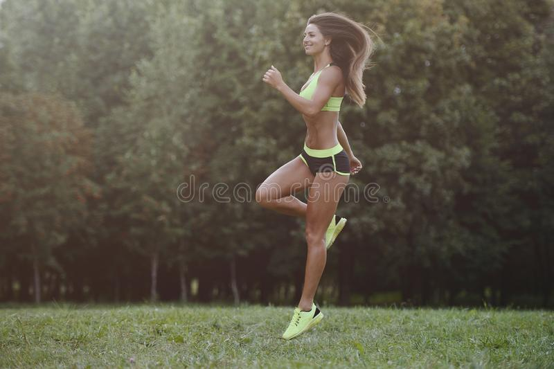 Outdoor sport Beautiful strong athletic muscular young caucasian fitness woman workout training in the gym on diet pumping up. Abs muscles and posing royalty free stock photography