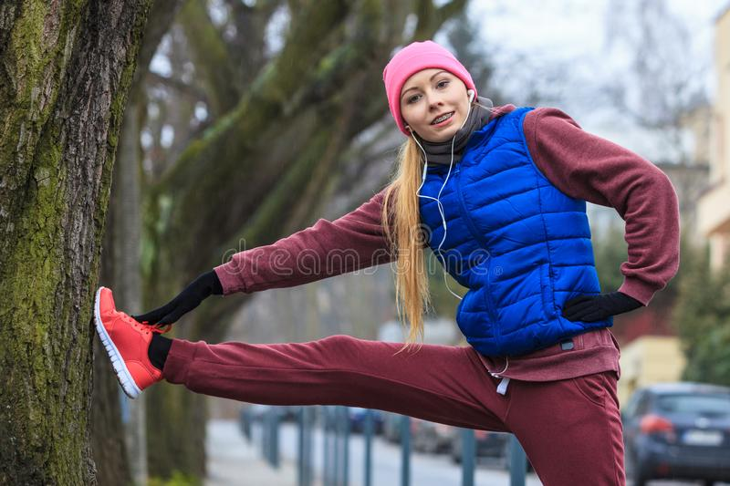 Woman wearing sportswear exercising outside during autumn royalty free stock photo