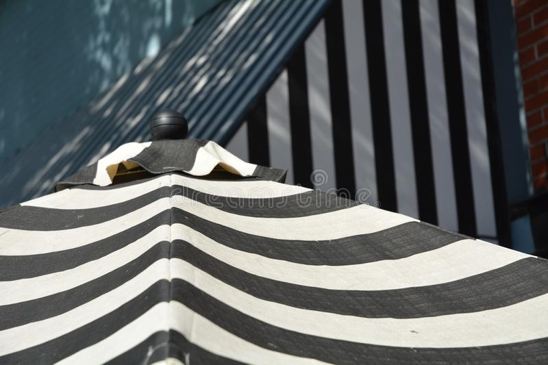 Outdoor stripes in Salem, Oregon. This is an image of a black and white striped awning and umbrella on a street in downtown Salem, Oregon royalty free stock photo