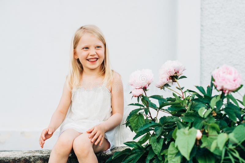 Outdoor summer portrait of happy adorable 5 year old little girl royalty free stock photography