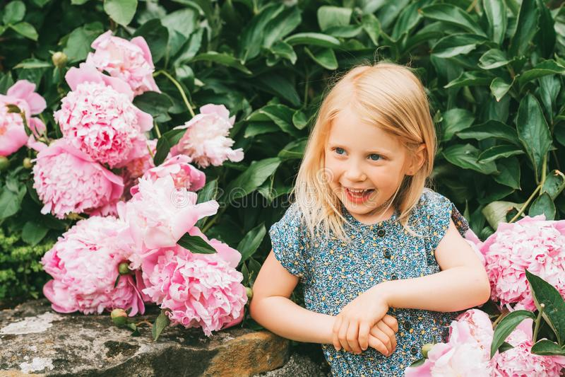 Outdoor summer portrait of happy adorable 5 year old little girl royalty free stock image