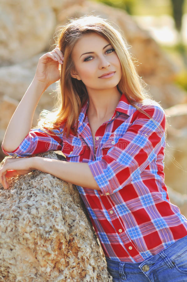 Outdoor summer portrait of young pretty cute blonde girl. Beautiful woman posing in spring. Fashion photo stock photography