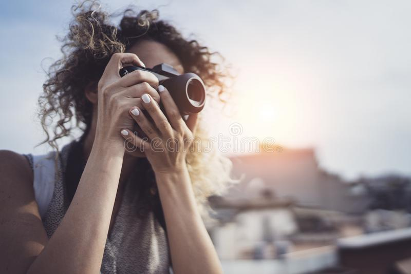 Outdoor summer smiling lifestyle portrait of pretty young woman having fun in the city in Europe in evening with camera stock image