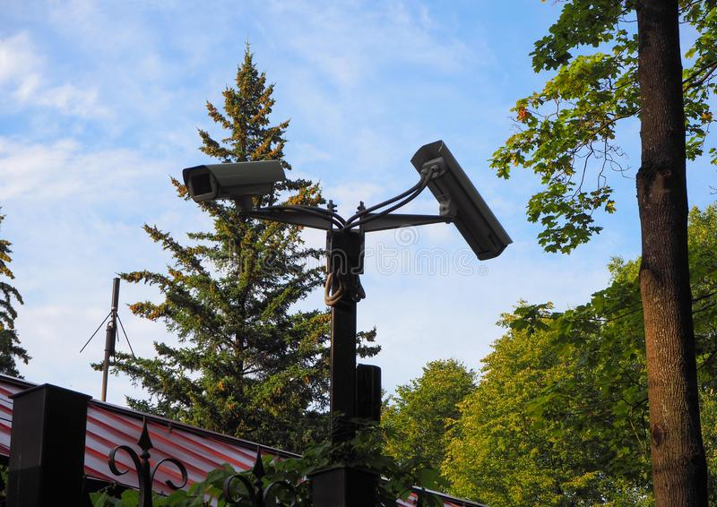 Outdoor surveillance camera installed on the gate of the courtyard in front of the house stock image